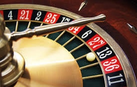 Playing Roulette at a live dealer casino.